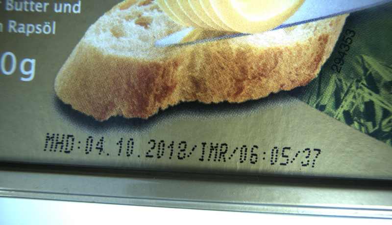 <b>Fig. 1:</b> <i>Image of butter package with dot-matrix printed best-by date</i>