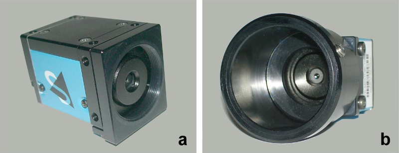 Fig. 1. Camera body. Front view showing screw thread for camera tube and aperture (a). Body with camera tube. View of the aperture and outermost lens (b).